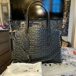 Coach Charlie sig emboss leather Carryall w/ rivet
